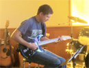 TeenChallenge Atlantic - Student Playing Guitar
